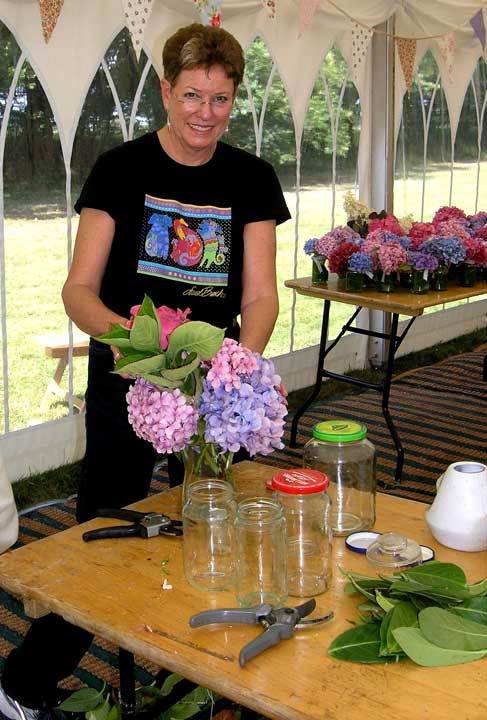 Jeanne putting flowers in jars