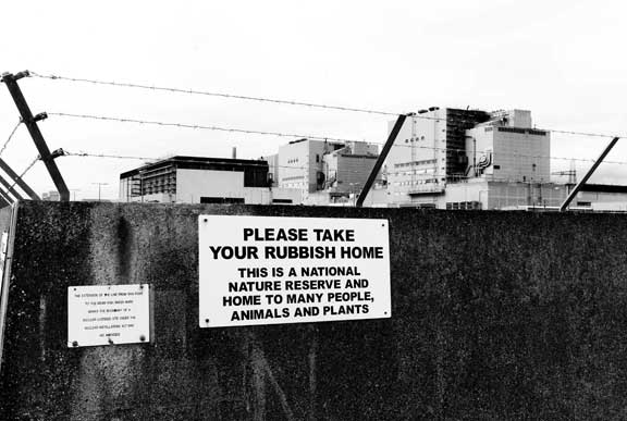 Dungeness nuclear plant with rubbish sign