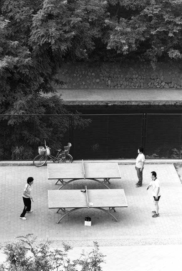 ping pong players at base of wall